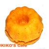 犬のケーキ作り、オレンジ色のミニクグロフケーキ。
